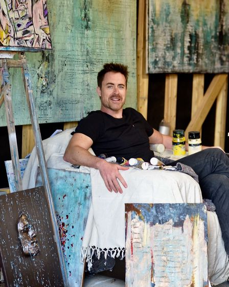 James in his studio near Alresford surrounded by his paintings Photo: Leela Bennett