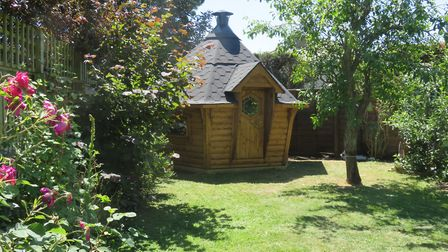 Our Hare Lodge tucked into the corner of a garden