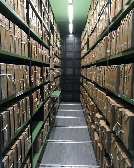 Among the archives (Photo by Claire Saul)