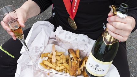 A London to Brighton charity bike rider celebrates with a well-earned seaside feast.