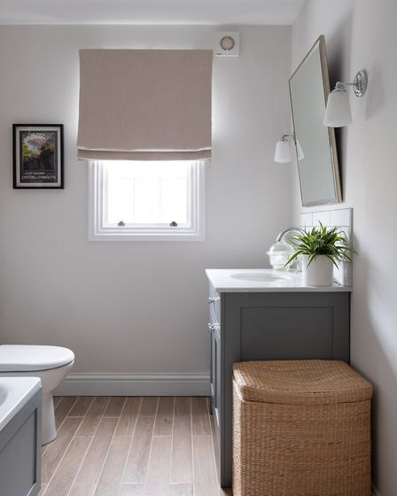 The flooring in the refurbished bathroom is new engineered oak, also laid in the hall and kitchen. T