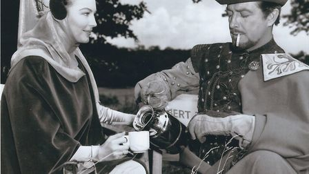 Ava Gardner and Robert Taylor on a tea break during filming of 1953's Knights of the Round Table