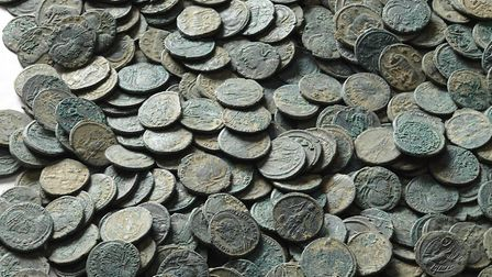 Part of the hoard of 22,888 coins from the late Roman period found near Seaton. PICTURE: RAMM