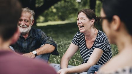 Laughter yoga can be done in groups - and it's easy to socially distance yourselves too