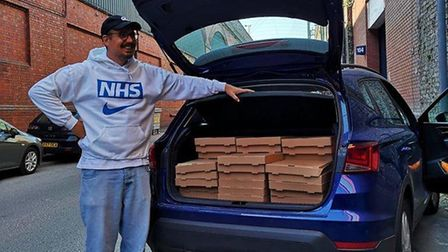 Andy Johnson from Honest Crust loads up a boot full of pizzas for key workers and vulnerable people
