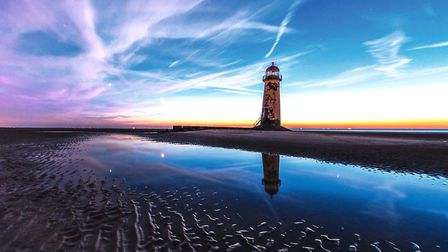 Talacre beach with the reflection of Venus and Jupiter in the water Photo: Nigel A Ball