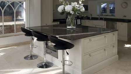 Adding built-in breakfast bars, wine fridges and mobile phone charging points to your kitchen island