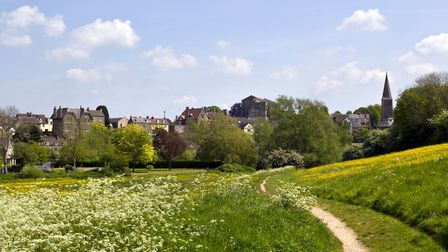 The historic Malmesbury Abbey and the town in spring sunshine in the Cotswolds (photo: Getty Images)