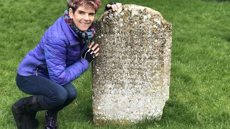 Tracy with the grave of Hannah Twynnoy, killed by a tiger in 1703 (photo: Tracy Spiers)