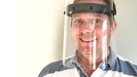 Orthotropic Engineering director Matthew Dawson with one of their face visors (GWP Group and Orthotr