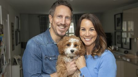 Nick and Andrea with their dog Teddy at home in Ashtead