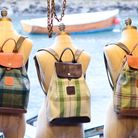 The beautiful bespoke bags and accessories - many adorning the signature bee design - come in a rang