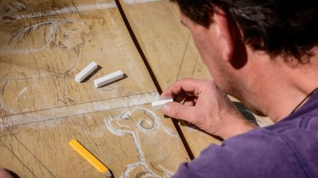Left and right: Keith Pettit at work on sculptures to appear on the 1066 Country Walk for Rother Dis