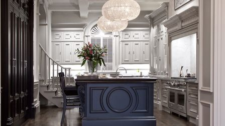 The Huxley kitchen from Clive Christian Furniture features a bold blue centre island Photo: James R