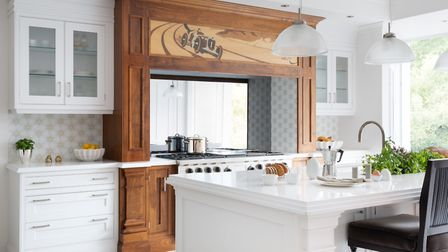 This kitchen, showcasing the Clive Christian Furniture Alpha design, has a bespoke marquetry panel a