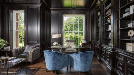 Black walnut panelling is used to dramatic effect in this study built by Clive Christian Furniture f