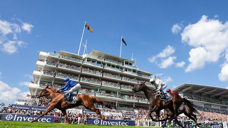 William Buick riding Masar wins The Investec Derby race 2018 INVESTEC Derby Festival June 2nd 201