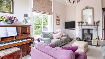 Annie chose a soft rose paint for her living room, inspired by the soft, warm light cast through the