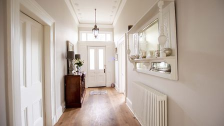 The hallway is painted in Farrow & Ball ammonite