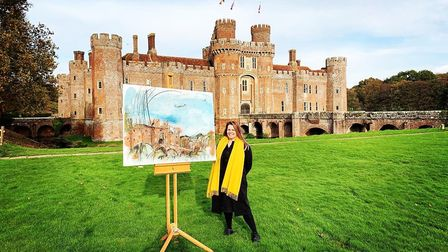 Faye pictured outside Herstmonceux Castle with the painting she created for Sky Arts' Landscape Pain