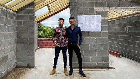 Thomas and Kunal, in what will become their master bedroom suite, with glorious views across the Che
