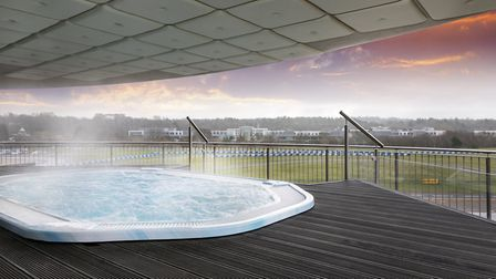 The hot tub at Brooklands Hotel overlooks the circuit at Mercedez Benz World opposite. Image: Suppli