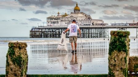 Oliver Sterno on Eastbourne seafront ahead of a mass post-lockdown weekend litter pickPhoto: Jim Ho