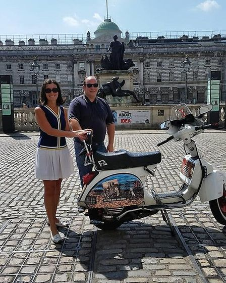 Carl Grisley and Gina Guarnieri with his scooter named Little Boy Soldier