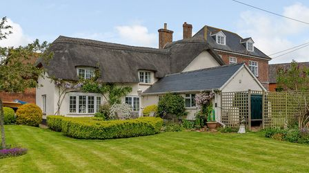 Denbow Thatch at Farringdon has a guide price of £470,000. Photo: Strutt and Parker