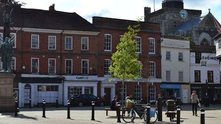 Romsey's Market Place has been recreated as a public open space with trees and seats, watched over b