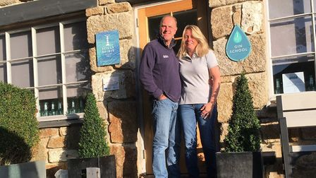 Arthur and Hilary outside their little granite contemporary distillery. Photo: Scilly Spirit