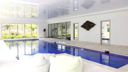 The leisure suite has a polished ceiling that reflects the pool below