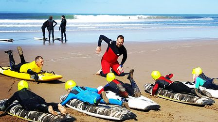 Young members hone their paddle skills on the beach. Photo: Croyde Surf Life Saving Club