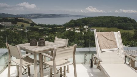 An upstairs terrace, complete with perfectly positioned sun loungers make you feel as if you've jett