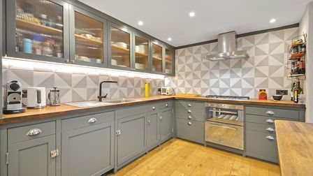 In the kitchen the Shaker-style units were handmade and painted in Paint and Paper Librarys Squid In