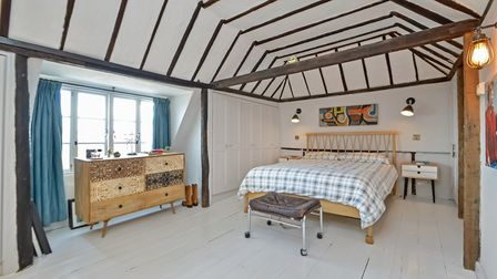 The master bedroom suite occupies the third floor and features a vaulted ceiling