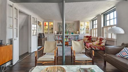 The atmospheric sitting room with pillars, beams and original floorboards plus mix of antique, vinta