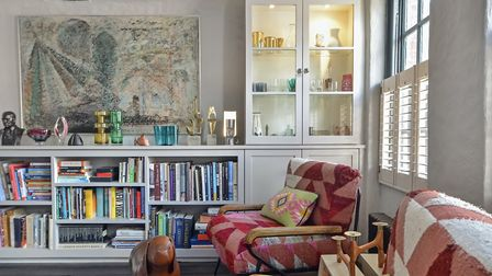A corner of the sitting room with bookshelves and cabinets by Richard and display of art including c