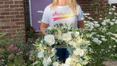 This white floral summer wreath will glow in bright sunshine or purple twilight Photo: Henry Harris