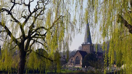 The parish church of St Peter and St Paul looms over Godalming's riverside park. Image: Getty