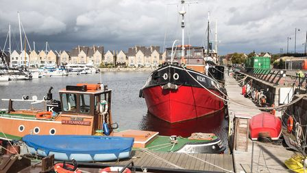 The motor tug Kent and her little sister, the 1966 tosher tug Fearnought, are moored in Chatham Mari