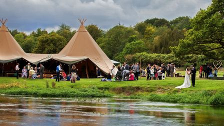 Utopian Tent Company 'Event Tipis' on the bank of the River Itchen