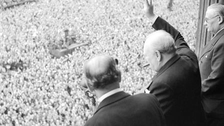 Churchill waves to crowds in Whitehall on the day he broadcast to the nation that the war with Germa