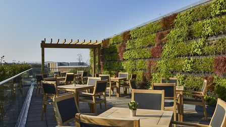The roof terrace has wide views across the city and into the countryside beyond