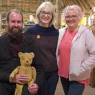 Julie Tatchell and Amanda Middleditch on the set of The Repair Shop with bear owner John McMuldoch c