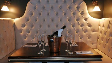 Comfortable seating booths line the walls of the venue. Photo: The Stand Off