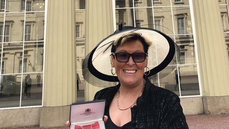 Mary Pugsley proudly shows off her MBE, having received it at Buckingham Palace. Photo: Mary Pugsley