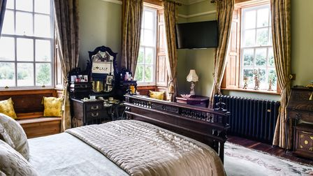 The master bedroom is filled with light from a multitude of windows Photo: Fiona Bailey Photography