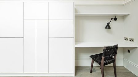 Use pared-back furniture and fitted joinery in natural textures and neutral tones to help guide the