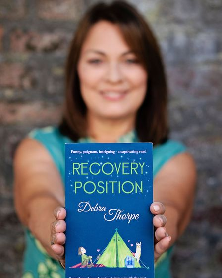 Debra Thorpe with her first novel, Recovery Position